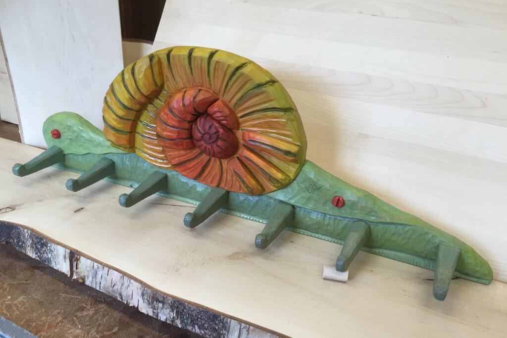 Samiskt hantverk knoppbräda snigel